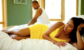 black_couple_in-bed_sad_woman
